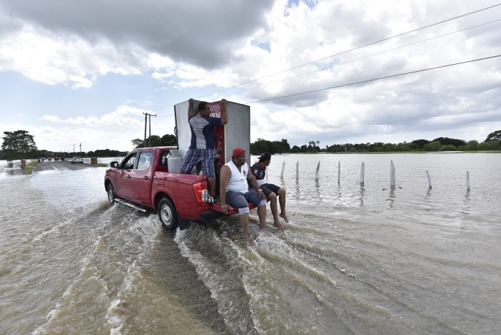 People rescue their belongings after a flood due to heavy rains by the tropical storm Gamma, at Las Gaviotas colony in Tabasco, Mexico, 04 October 2020.