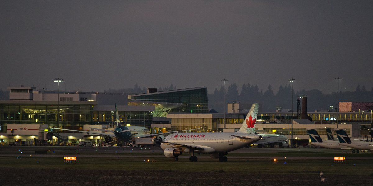 An Air Canada Airbus A319 jet (C-GBIP) waits to taxi across an active runway at Vancouver International Airport, Richmond, B.C. on Monday, October 5, 2020.