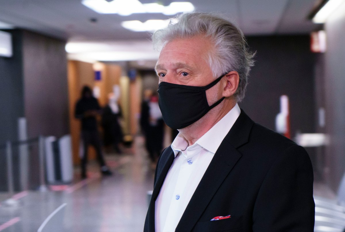 Just for Laughs founder Gilbert Rozon walks the hall of the courthouse as he arrives for the beginning of his sexual assault trial in Montreal on Tuesday, October 13, 2020.