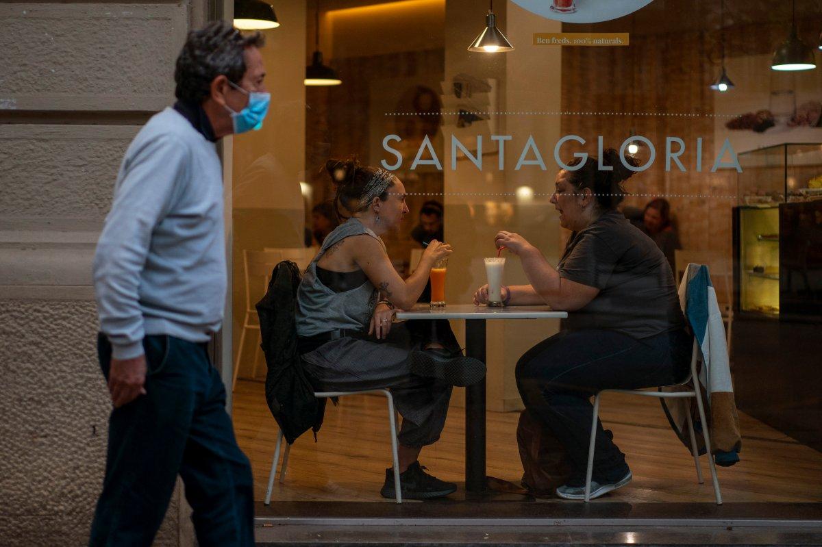 Customers sit inside a bar in Barcelona, Spain, Thursday Oct. 15, 2020.