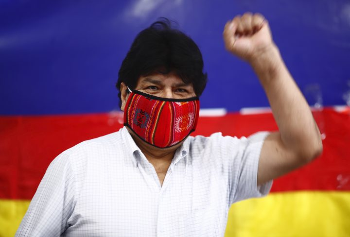 Former Bolivian President Evo Morales raises his fist as he arrives for a press conference at Movement Towards Socialism (MAS) headquarters in Buenos Aires, Argentina, during general elections in his home country, Sunday, Oct. 18. 2020.