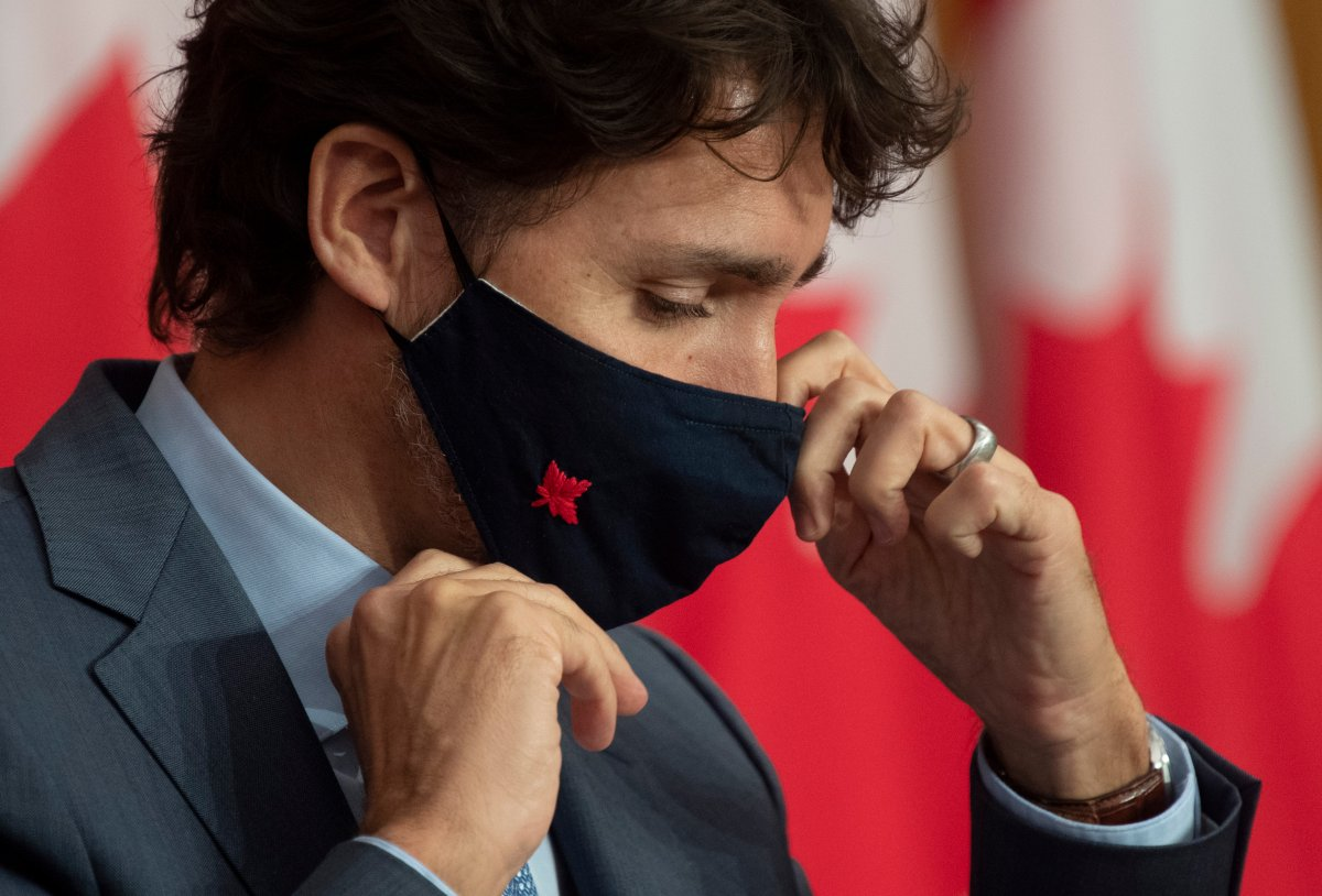 Prime Minister Justin Trudeau adjusts his mask as he leaves a news conference Tuesday October 20, 2020 in Ottawa.