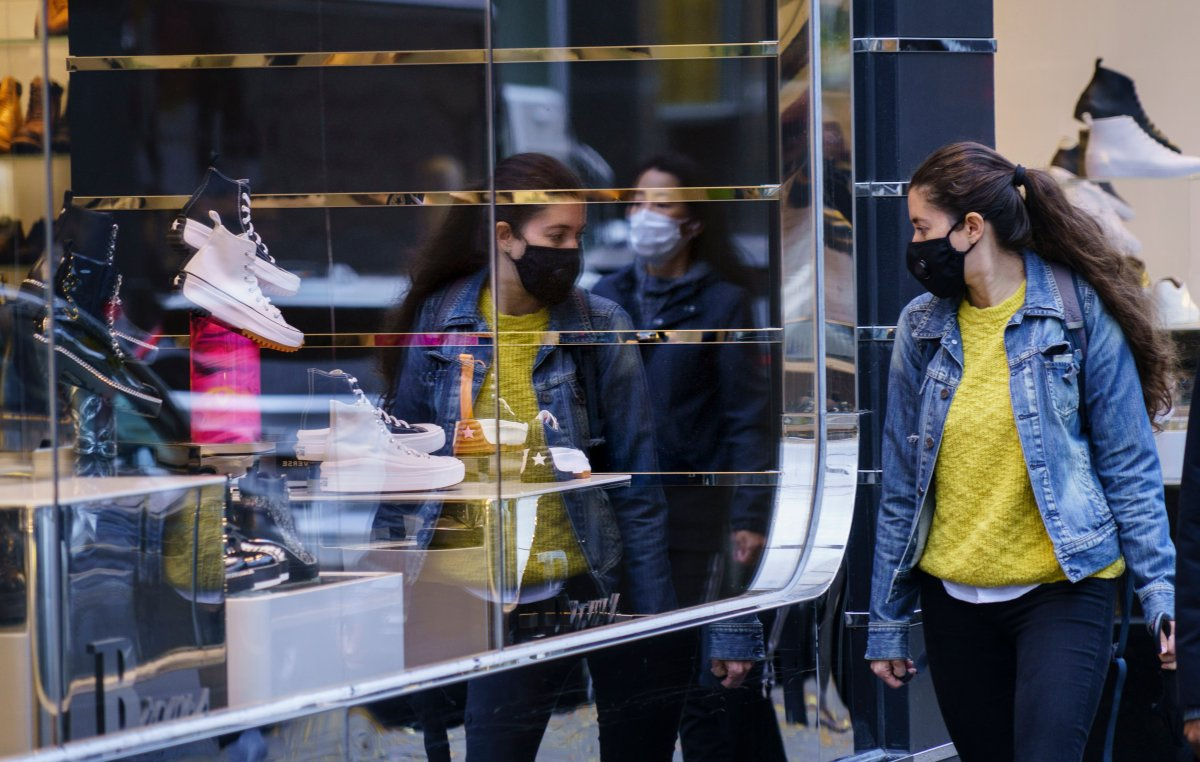 A woman does a bit of window shopping along Montreal's Sainte-Catherine Street, on Tuesday, Oct. 20, 2020.
