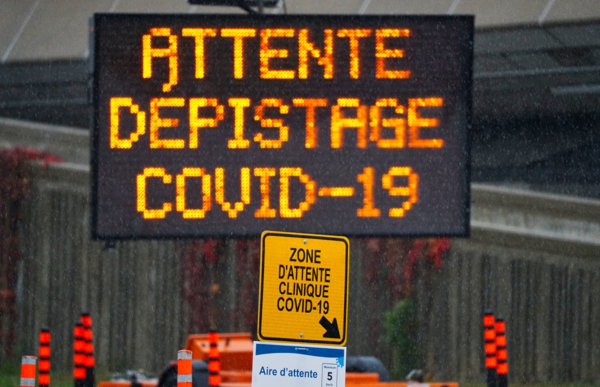 Sign indicating waiting line for the drive-thru testing of COVID-19 in Montreal, Que., Wednesday, October 21, 2020.