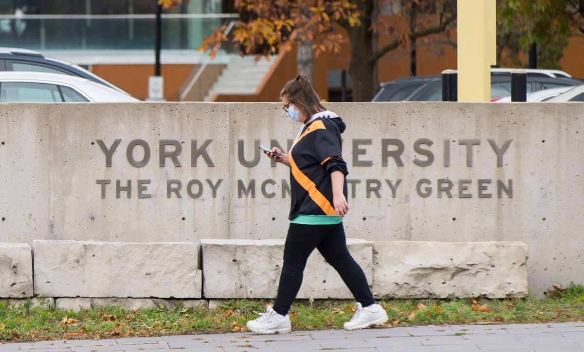 TORONTO, Oct. 20, 2020 A student wearing a face mask walks at York University in Toronto, Canada, on Oct. 20, 2020.