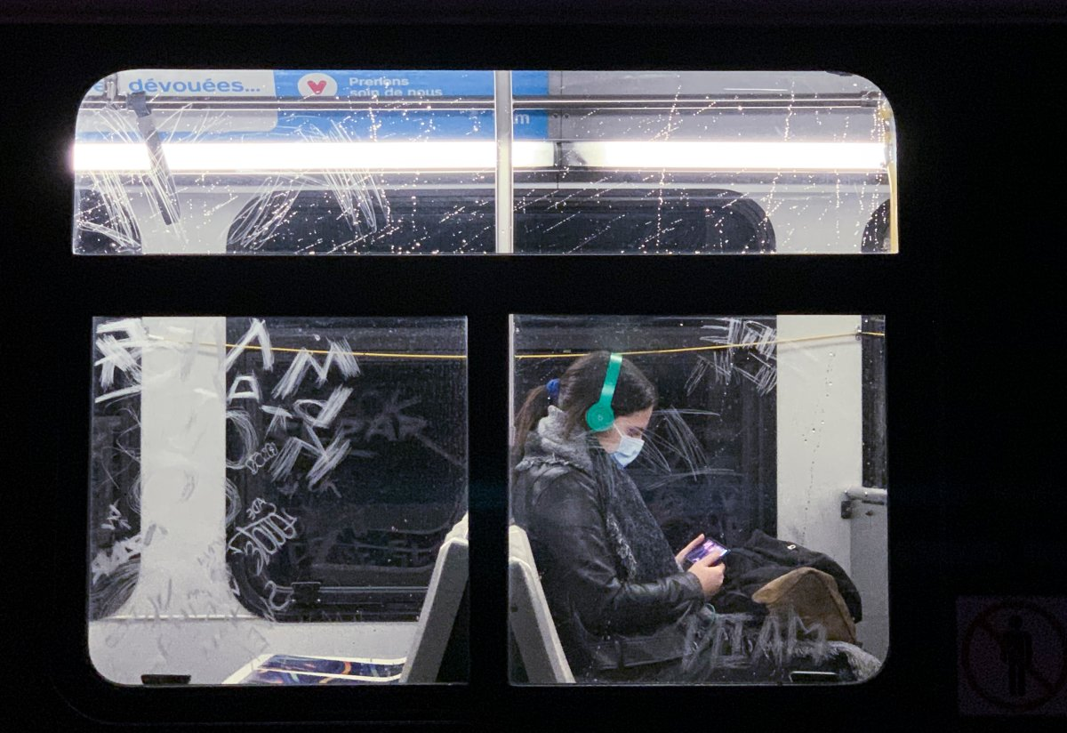 A woman wears a face mask as she commutes on a city bus in Montreal, Monday, Oct. 19, 2020, as the COVID-19 pandemic continues in Canada and around the world.