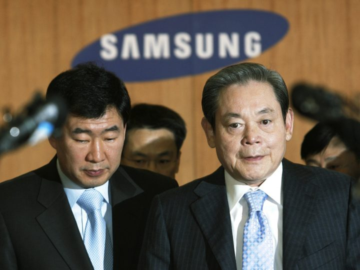FILE - In this April 22, 2008, file photo, Samsung Group Chairman Lee Kun-hee, right, arrives to hold a news conference at the Samsung Group headquarters in Seoul, South Korea. Lee, the ailing Samsung Electronics chairman who transformed the small television maker into a global giant of consumer electronics, has died, a Samsung statement said Sunday, Oct. 25, 2020. He was 78.