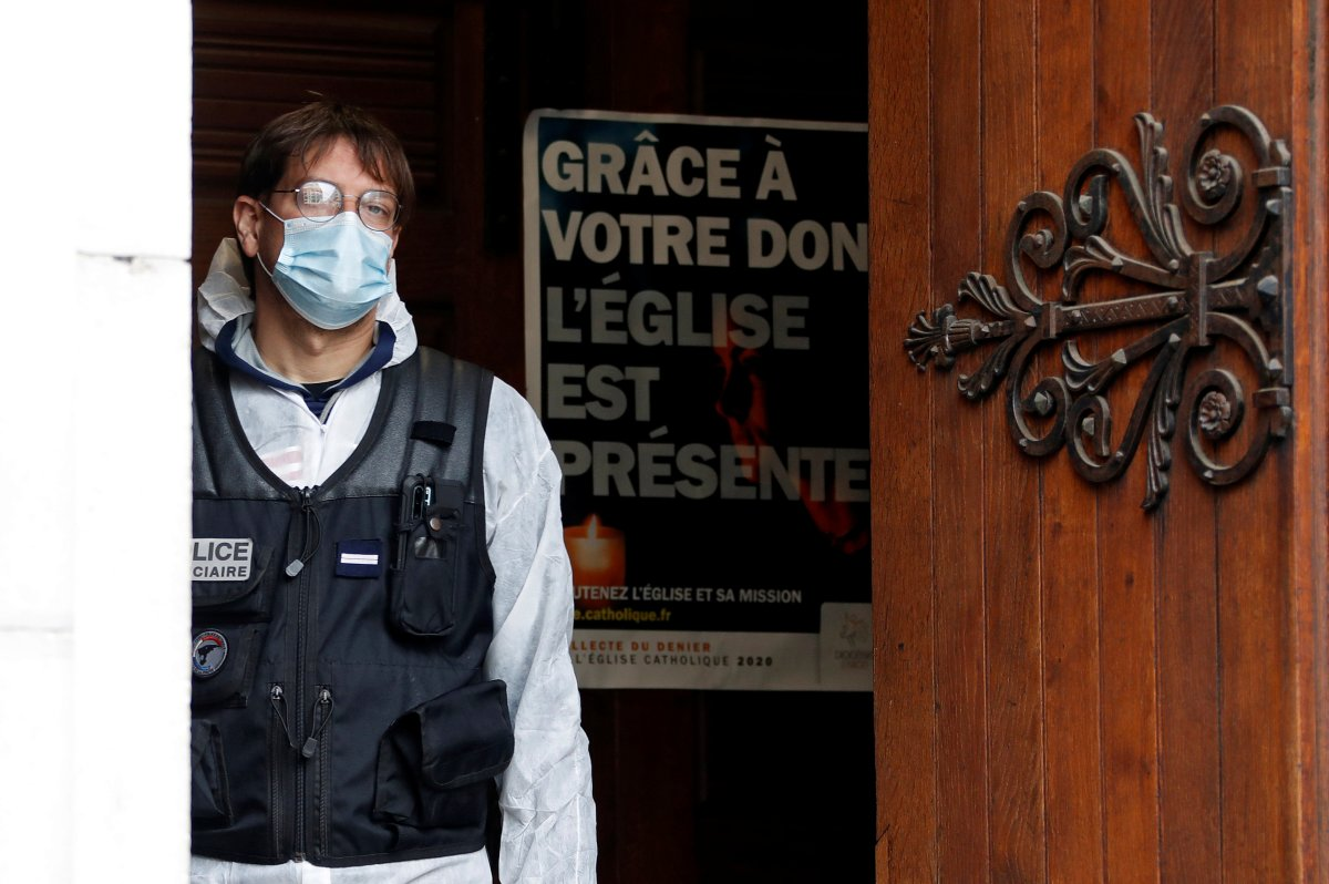 A police officer stands at the entrance of the Notre Dame church in Nice, southern France, Thursday, Oct. 29, 2020.