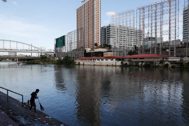 A man cleans stairs along a river with empty billboards in preparation for typhoon Goni in Pasay City, Philippines, 31 October 2020. According to reports, typhoon Goni is now a super typhoon with its winds forecasted to reach 249 kilometers per hour. Goni is expected to make landfall in the eastern provinces of Aurora and Quezon and make its way through Central Luzon on the evening of 01 November or morning morning of 02 November, according to the local weather bureau.