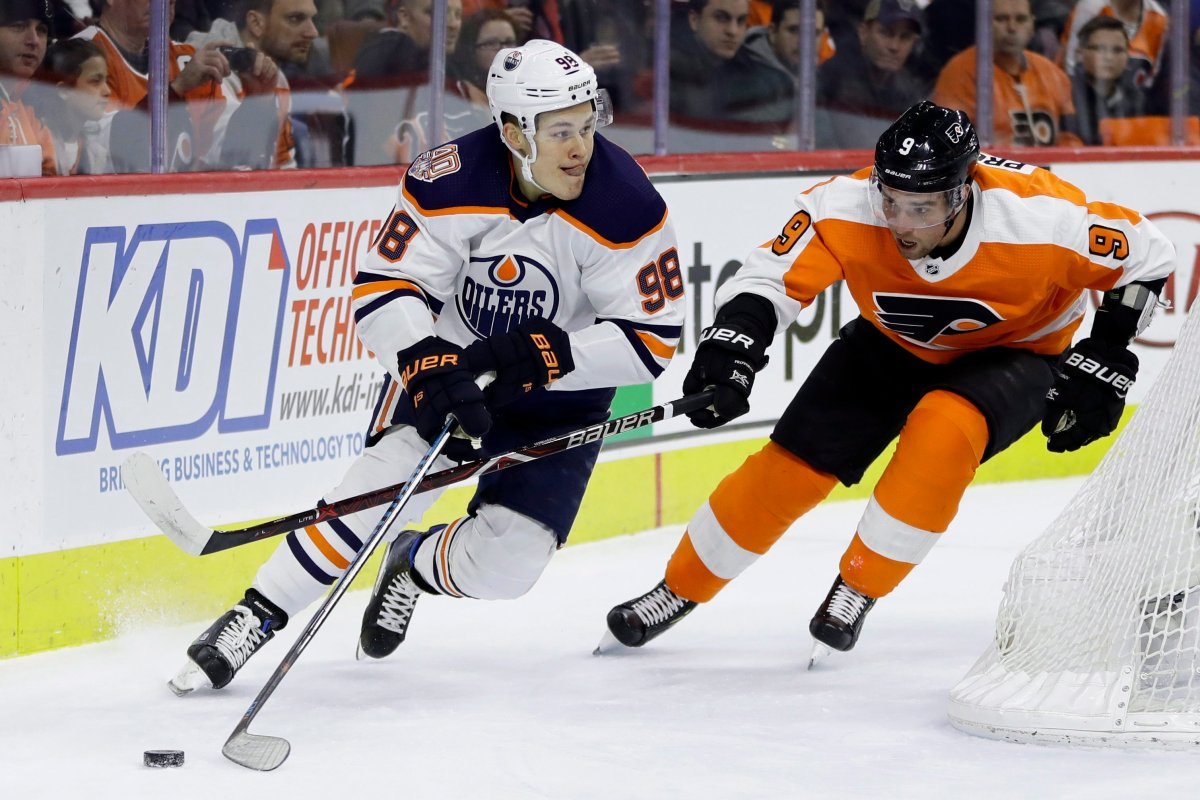 Edmonton Oilers' Jesse Puljujarvi, left, tries to keep the puck away from Philadelphia Flyers' Ivan Provorov during the first period of an NHL hockey game, Saturday, Feb. 2, 2019, in Philadelphia. (AP Photo/Matt Slocum).