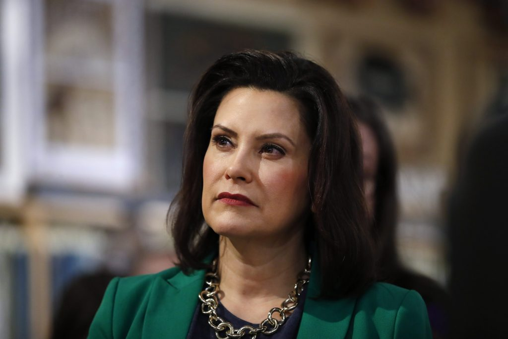 """FILE--In this March 18, 2019, file photo, Michigan Governor Gretchen Whitmer listens to Democratic presidential candidate Sen. Kirsten Gillibrand, D-N.Y., in Clawson, Mich. Whitmer is directing Michigan's environmental agency to develop drinking water standards for certain toxic industrial chemicals rather than waiting for updated federal guidelines. The rules will cover long-lasting """"forever"""" chemicals known as perfluoroalkyl and polyfluoroalkyl substances, or PFAS, which were long used in firefighting, waterproofing, carpeting and other products. The Democrats says she will not wait for the Trump administration to act."""