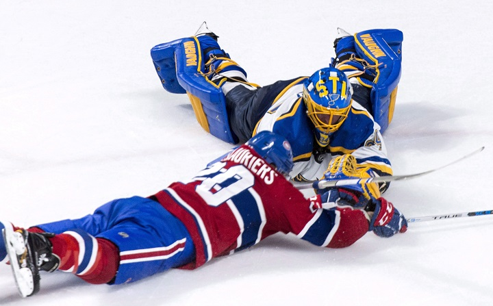 In this 2017 file photo, former St. Louis Blues goalie Jake Allen and Montreal Canadiens' Nicolas Deslauriers dive for the puck during NHL hockey action in Montreal. Allen signed a two-year contract extension with the Habs worth US US$2.875 million per season. Wednesday, Oct. 14, 2020.