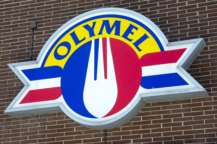 In this March 2020 file photo, an Olymel sign is seen outside a facility in Anjou. So far, 65 workers at an Olymel owned plant in the Beauce region have tested positive for COVID-19. Thursday, Oct. 22, 2020.