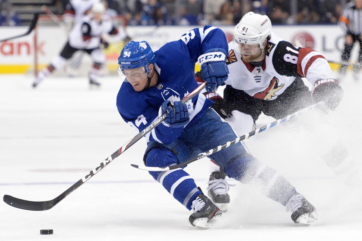 Tyson Barrie (94) turns hard with the puck as Arizona Coyotes right wing Phil Kessel (81) defends during first period NHL hockey action in Toronto on Tuesday Feb. 11, 2020. THE CANADIAN PRESS/Nathan Denette.