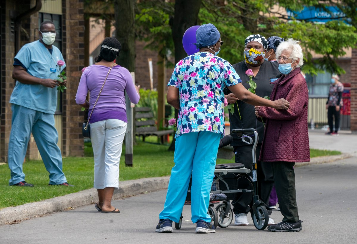 A resident chats with workers at Orchard Villa Long-Term Care in Pickering, Ontario on Monday June 1, 2020.