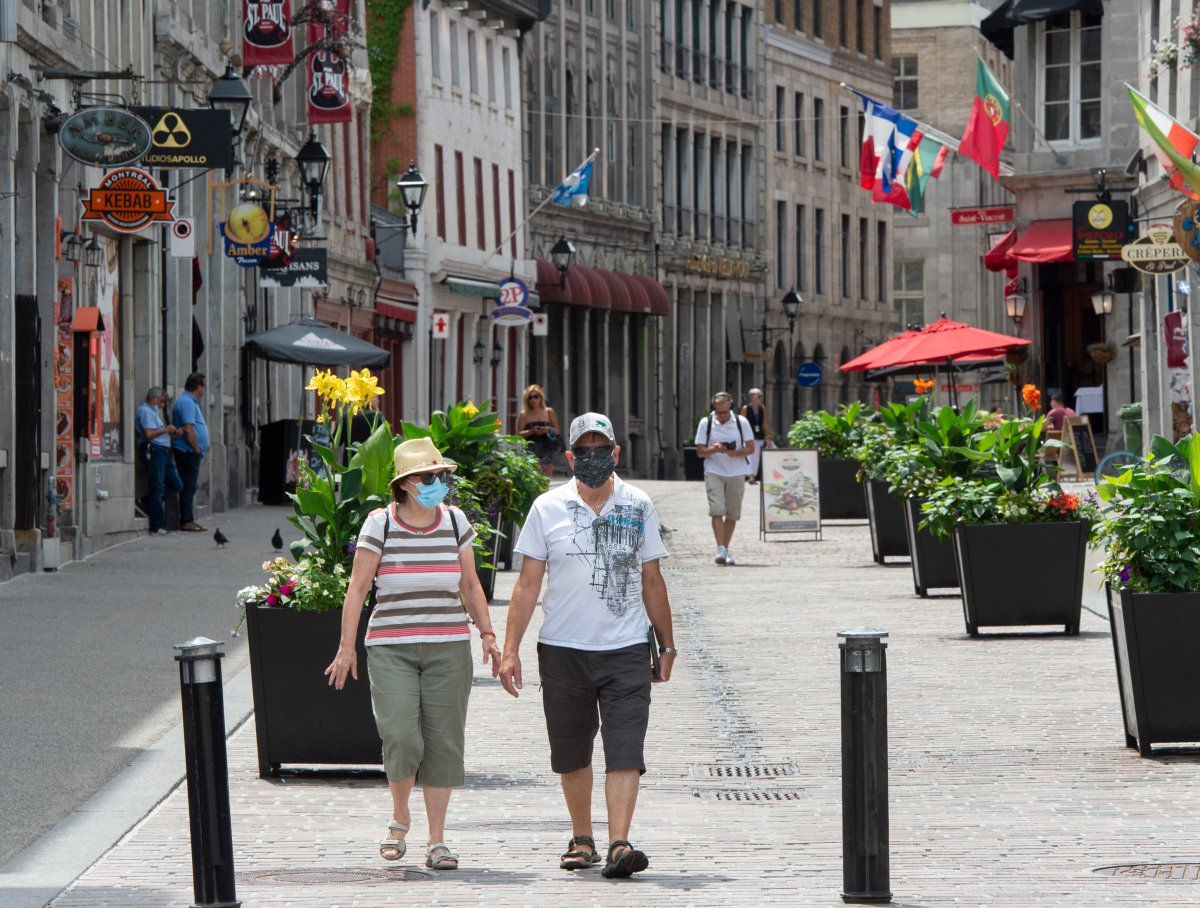 People walk through Old Montreal, Wednesday, July 22, 2020.