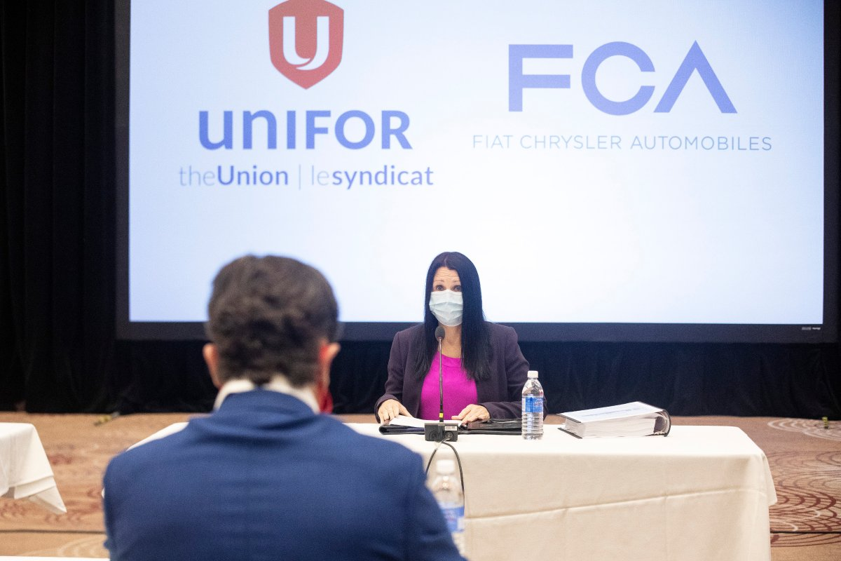 Jacqueline Oliva, head of human resources for Fiat Chrysler Automobiles (FCA) Canada, sits opposite Jerry Dias, President of the Unifor union, at the start of formal contract talks with the Detroit Three automakers, Fiat Chrysler, Ford and General Motors, in Toronto, Wednesday, Aug. 12, 2020.