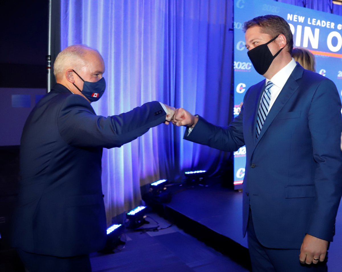 Conservative Party of Canada Leader Erin O'Toole fist bumps former leader Andrew Scheer after O'Toole's win at the 2020 Leadership Election, in Ottawa on Monday, Aug. 24, 2020.