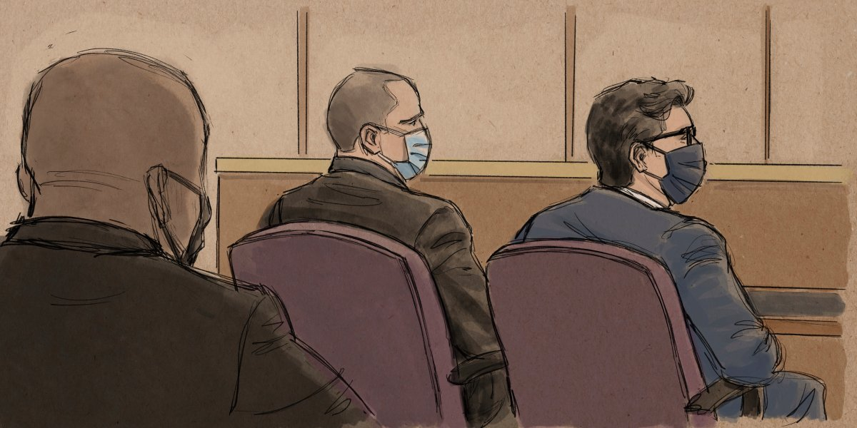 In this courtroom sketch, former Minneapolis police officer Derek Chauvin, center, sits beside his defense attorney during a hearing in Minneapolis, Friday, Sept. 11, 2020.