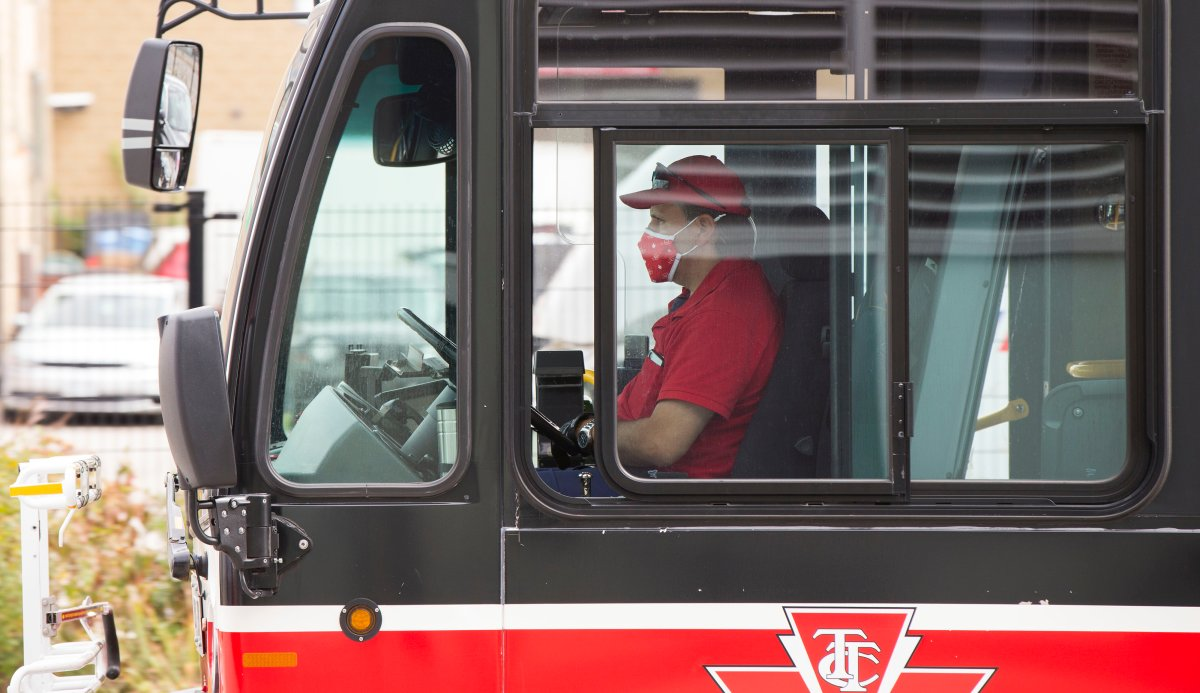 A TTC bus driver wearing a face mask is seen on a bus in Toronto on Sept. 17, 2020.