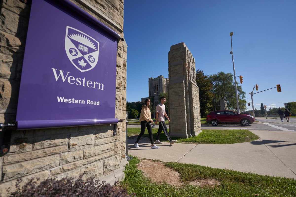 Students walk across campus at Western University in London, Ont., Saturday, Sept. 19, 2020.