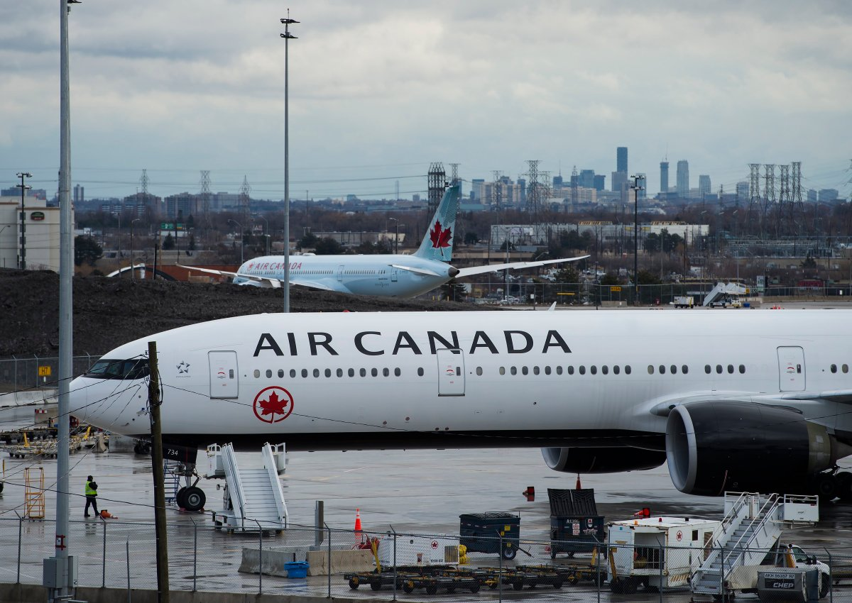 Air Canada airplanes sit on the tarmac at Pearson International Airport in Toronto on Friday, March 20, 2020. THE CANADIAN PRESS/Nathan Denette.