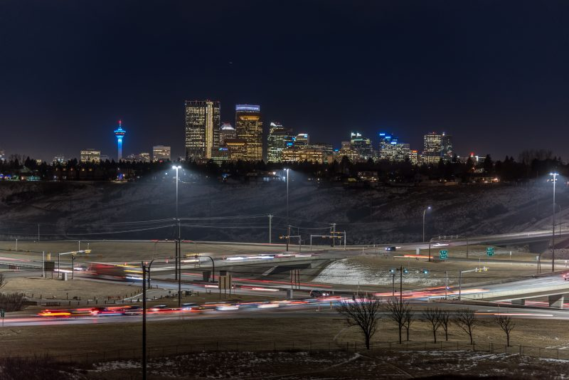 Calgary skyline at night with Deerfoot Trail in the foreground.