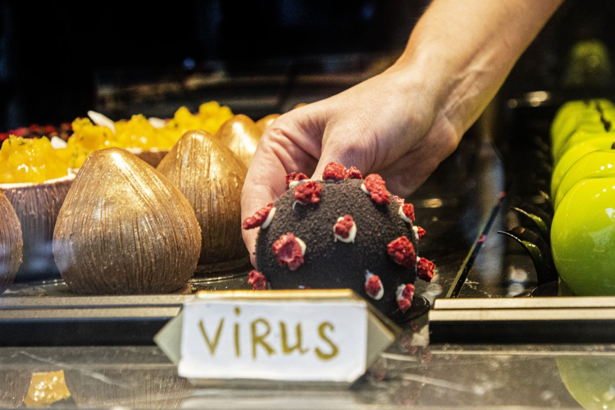 A waitress serves a dessert in shape of the Covid-19 coronavirus in a cafe on October 06, 2020 in Prague.