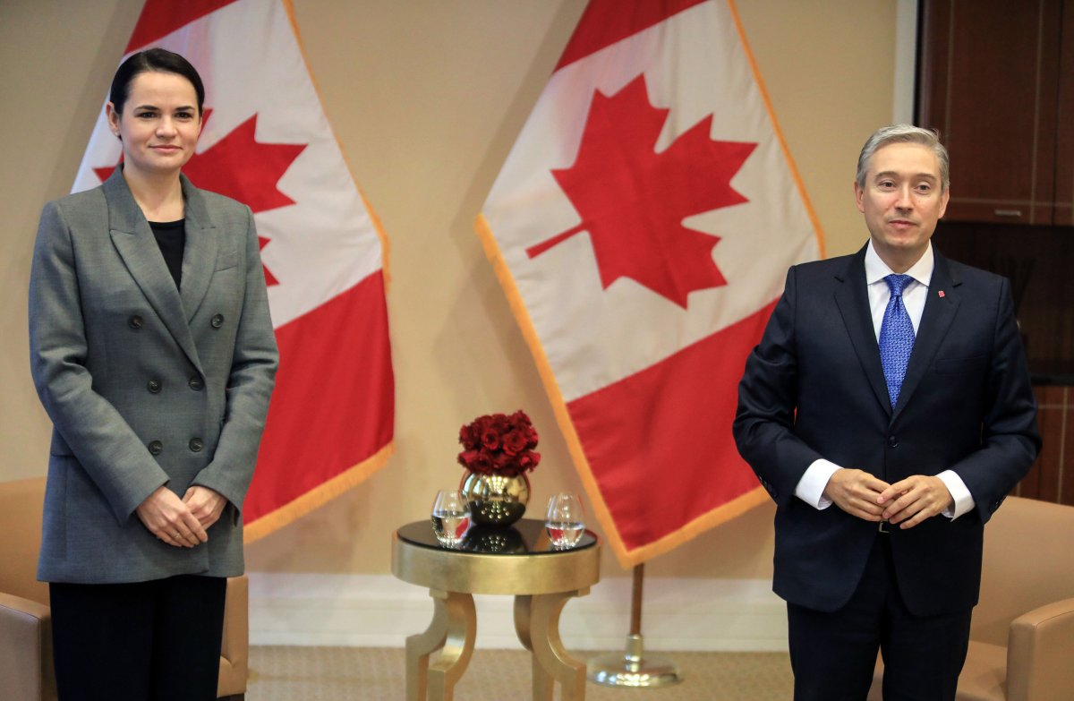 Canadian Foreign Minister François-Philippe Champagne poses with Belarusian opposition leader Sviatlana Tsikhanouskaya (L) prior to their meeting at the Kempinski hotel in Vilnius, Lithuania, on Oct. 16, 2020.