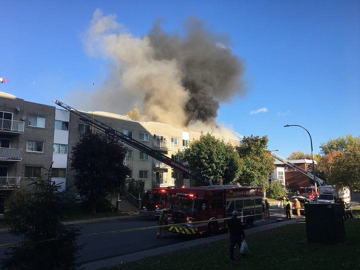 A five-alarm fire on Victoria Street in Greenfield Park has left dozens of families homeless. Wednesday, Oct. 14, 2020.