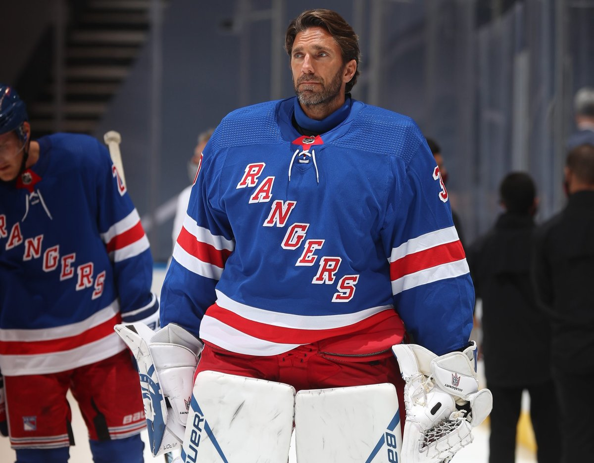 TORONTO, ONTARIO - AUGUST 04: Henrik Lundqvist #30 of the New York Rangers looks on after the ceremonial handshake after Game Three of the Eastern Conference Qualification Round prior to the 2020 NHL Stanley Cup Playoffs at Scotiabank Arena on August 04, 2020 in Toronto, Ontario. The Hurricanes defeated the Rangers 4-1 in this game to win the five-game series 3-0.
