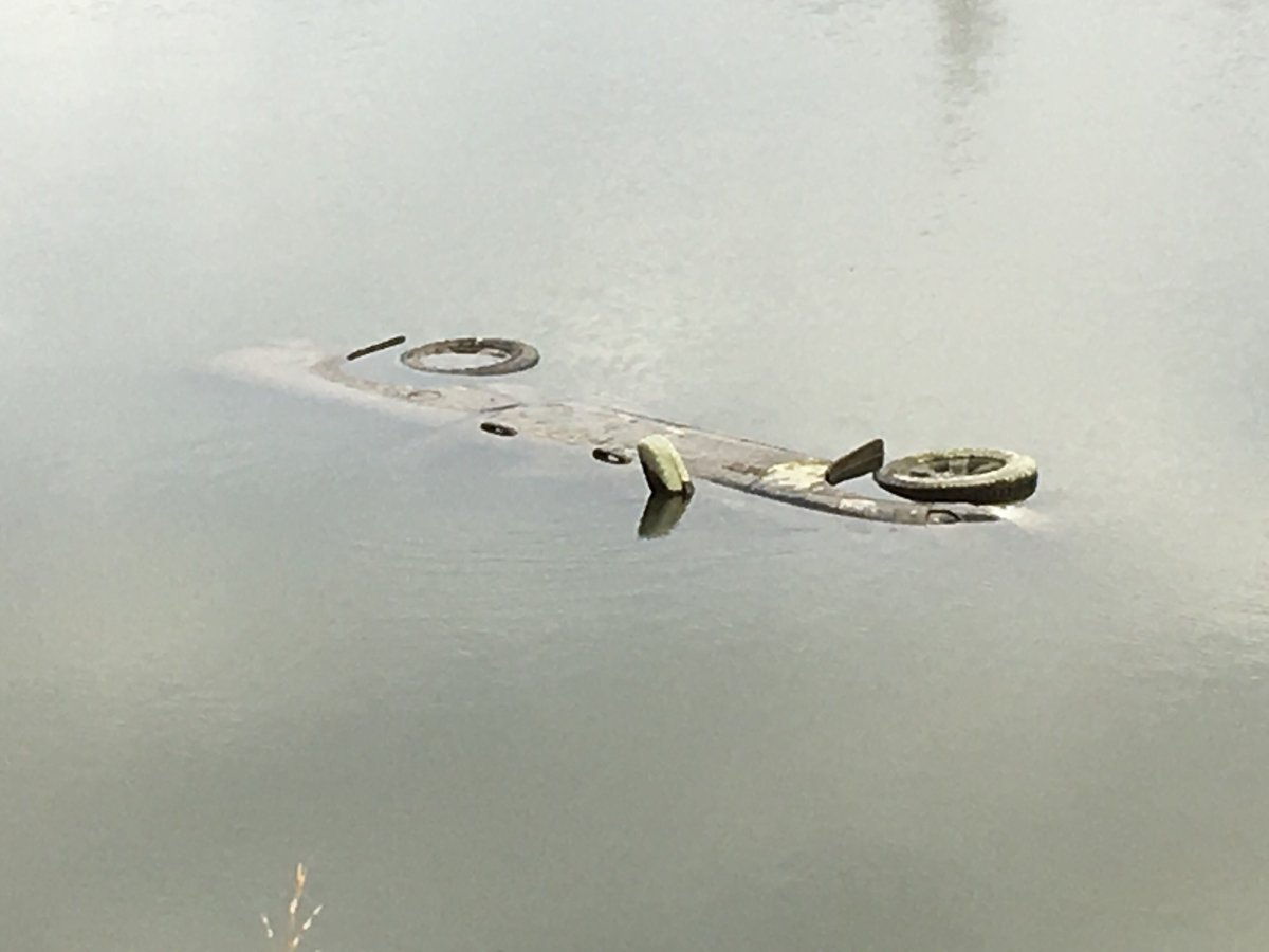 Winnipeg police were investigating a vehicle found in the water near Churchill Drive and Osborne Street Monday.