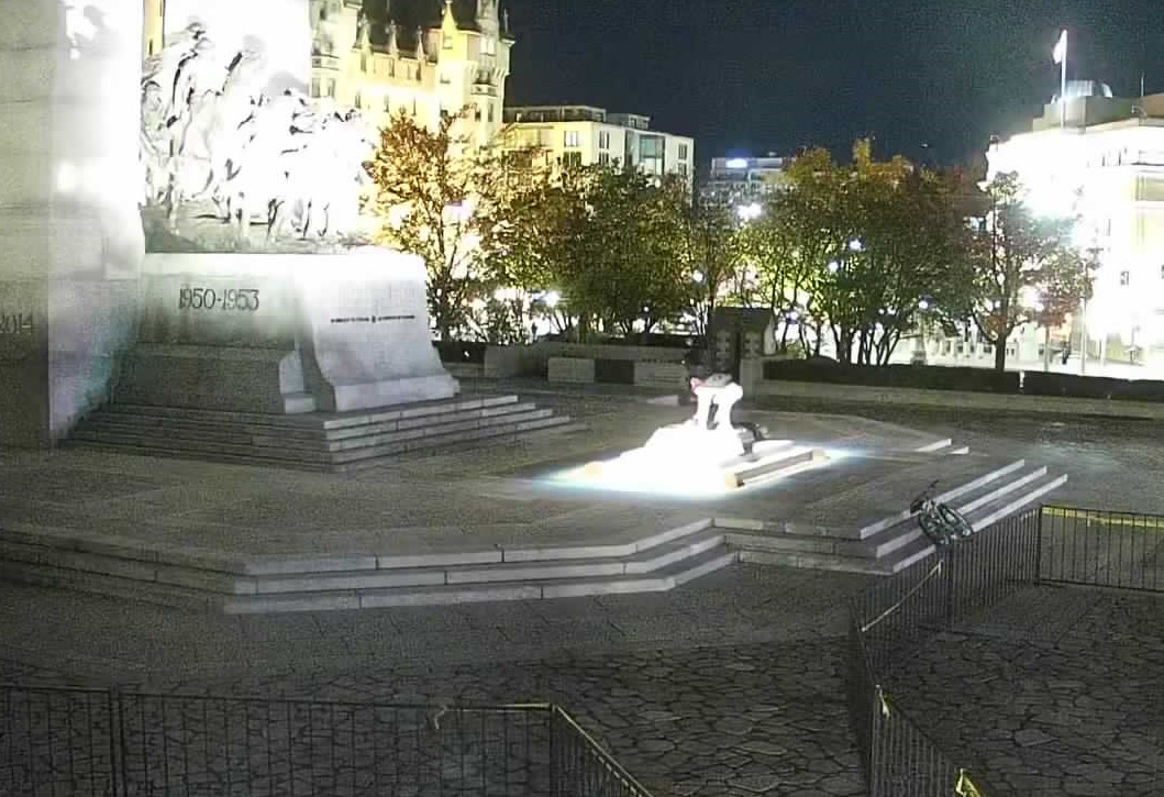 """A suspect is seen engraving """"hate graffiti"""" on the Tomb of the Unknown Soldier in this photo released by the Ottawa police."""