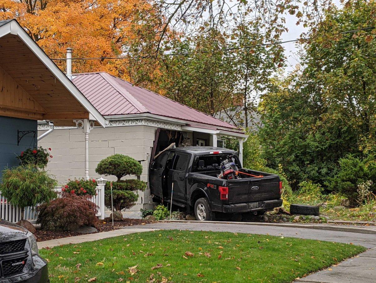 A truck struck a house on Elliott Street just before 3 a.m. Oct. 19, 2020.