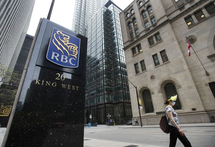 A person walks by the Royal Bank of Canada building on Bay Street during the COVID-19 Pandemic in Toronto on Wednesday, May 27, 2020.