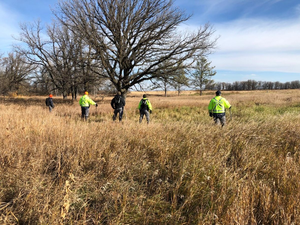 Manitoba RCMP search the Roseau River area Tuesday.