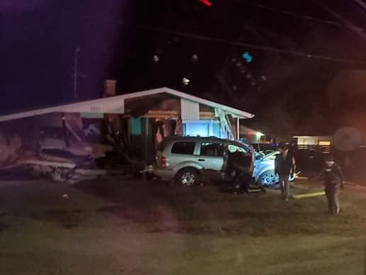 The scene of a multi-vehicle collision involving a home in Sandy Lake, MB on Friday.