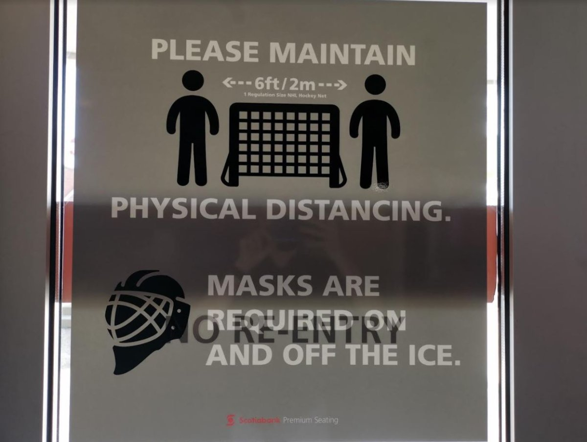 Social distancing signs like these can be seen throughout the Scotiabank Centre.