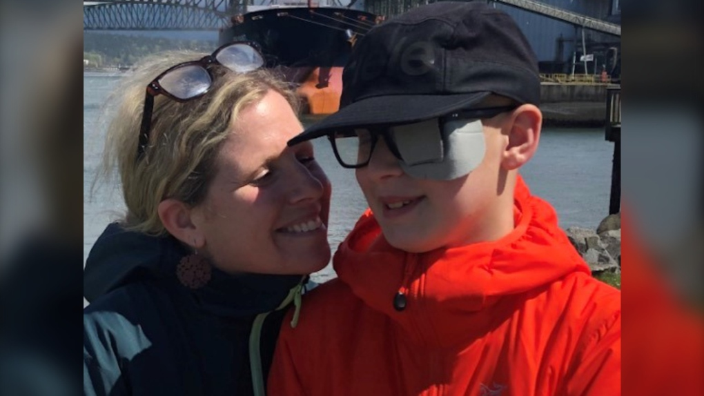 Kimberly Berger poses for a photo with her son, Jonah, 12, in this undated handout photo. Berger and her son travelled to Seattle, Wash., last February where he underwent proton beam therapy for a brain tumour at a private clinic.
