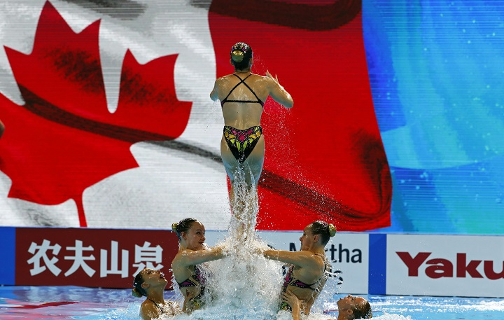 In this July 16, 2019 file photo, members of team Canada perform during  the FINA Swimming World Championships 2019 at the Yeomju gym in Gwangju, South Korea. Canada's artistic swim team has halted training at it's Montreal facility after complaints from athletes. Thursday, Oct. 1, 2020.