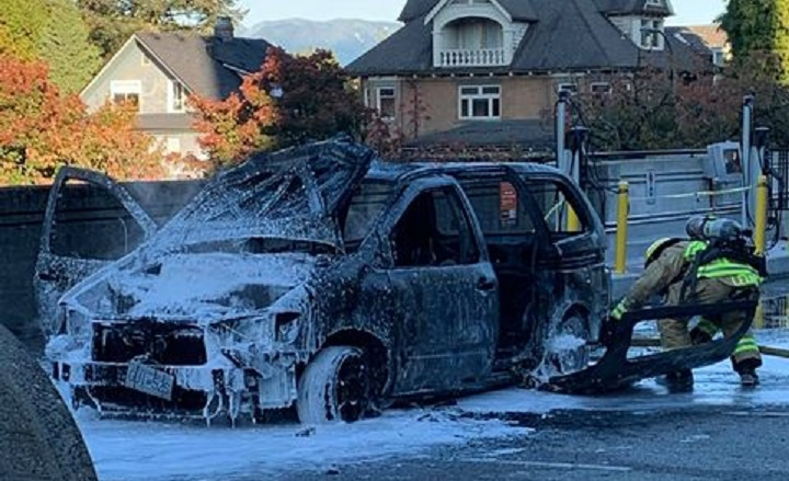 Fire crews extinguish a vehicle fire at Vancouver City Hall.