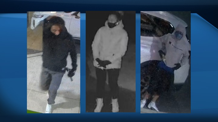 The first suspect is described to be a tall man, with a slim build, wearing a Champion sweater and a black mask, while the second suspect is described to be a man wearing a black sweater and mask.  The third suspect is described to be a tall woman, wearing a white coat, light-coloured boots and a black mask.