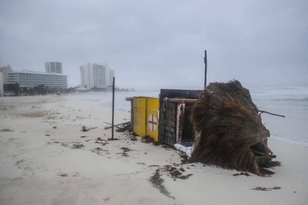 A lifeguard tower lays on its side after it was toppled over by Hurricane Delta in Cancun, Mexico, early Wednesday, Oct. 7, 2020.
