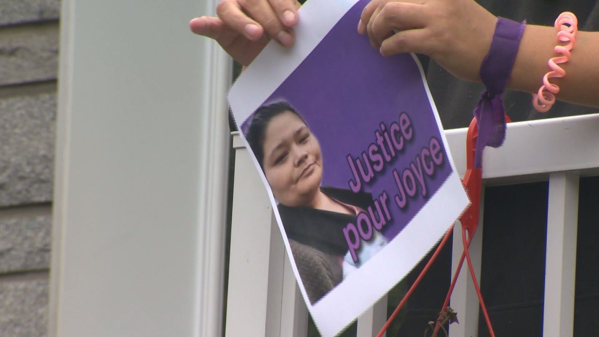 A woman holds up a sign that reads 'Justice for Joyce,' on September 29, 2020. The head of the regional health board that oversees the hospital where Joyce Echaquan died has been replaced. Wednesday, Dec. 2, 2020,.