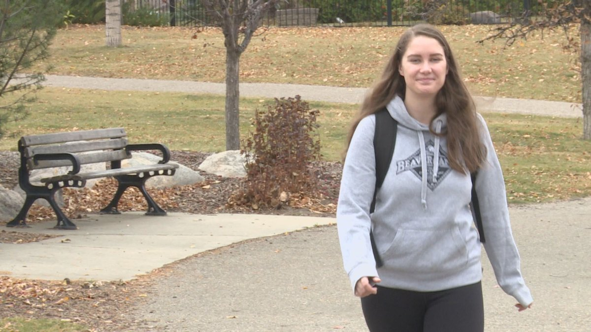 Kaelee Steele, 24, walks around Chinook Lake to begin her 24-hour-long trek across the city to fundraise for the homeless.