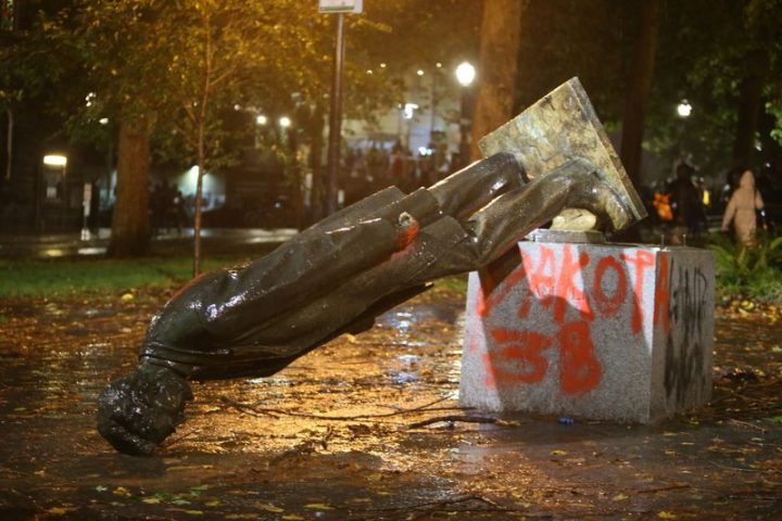 A group of protesters toppled statues of former presidents Theodore Roosevelt and Abraham Lincoln in Portland's South Park Block late Sunday, Oct. 11, 2020.