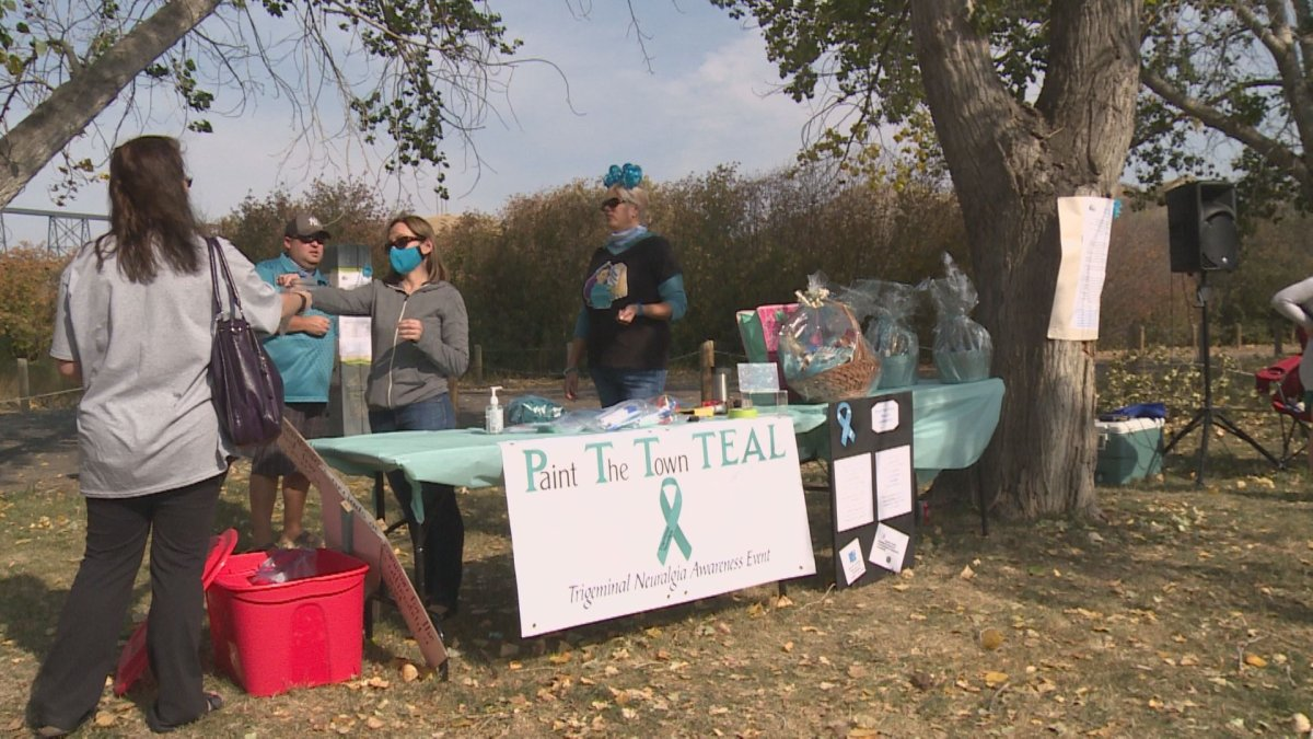 Participants of a scavenger hunt dressed in teal to raise awareness for trigeminal neuralgia on Sunday in Lethbridge.