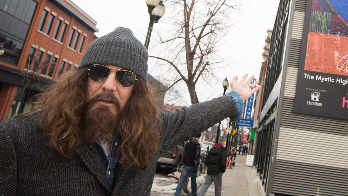 Juno Award winner Tom Wilson, (Lee Harvey Osmond, Blackie And The Rodeo Kings, Junkhouse) presents his work at the unveiling of The Mystic Highway, an oversized mural of his artwork in Hamilton, Ont.