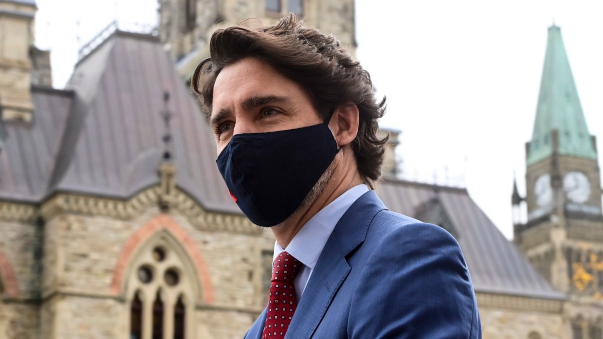 Prime Minister Justin Trudeau makes his way to a press conference during the COVID pandemic in Ottawa on Friday, Oct. 16, 2020.