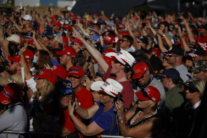 Attendees react as President Donald Trump speaks during a campaign rally on Oct. 18, 2020, in Carson City, Nev.